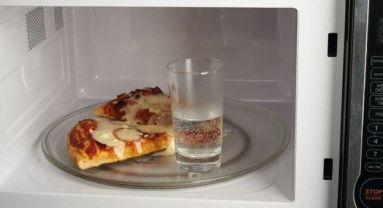 Put a small amount of water in a glass when you microwave your pizza to keep the crust from getting chewy.